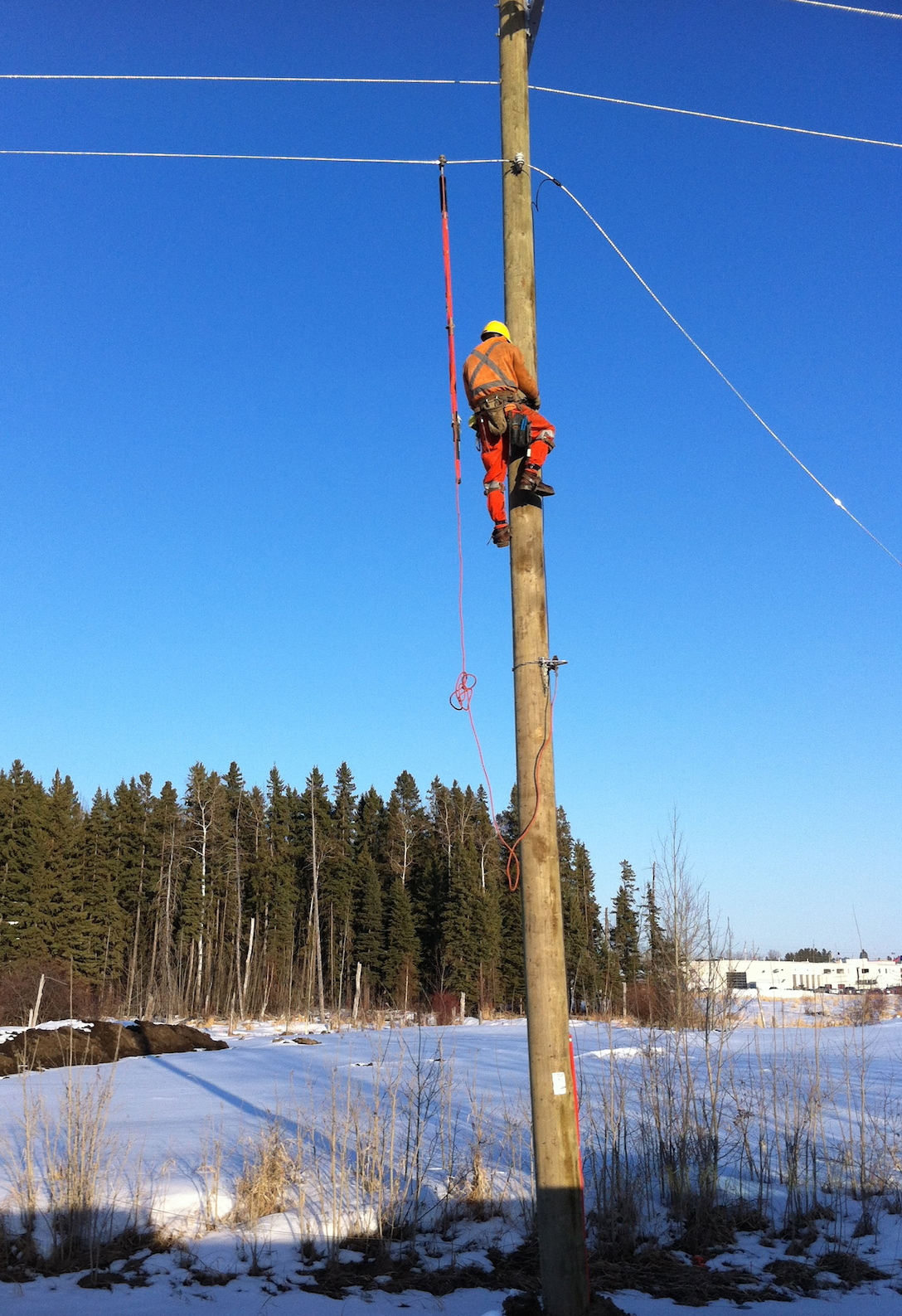Power Lineman hard at work