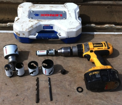 My hole saw kit spread out on the tailgate. Has all the general sizes