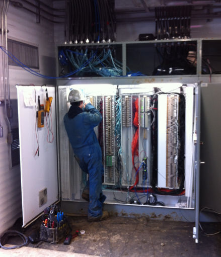 Journeyman Electrician Terminating a PLC